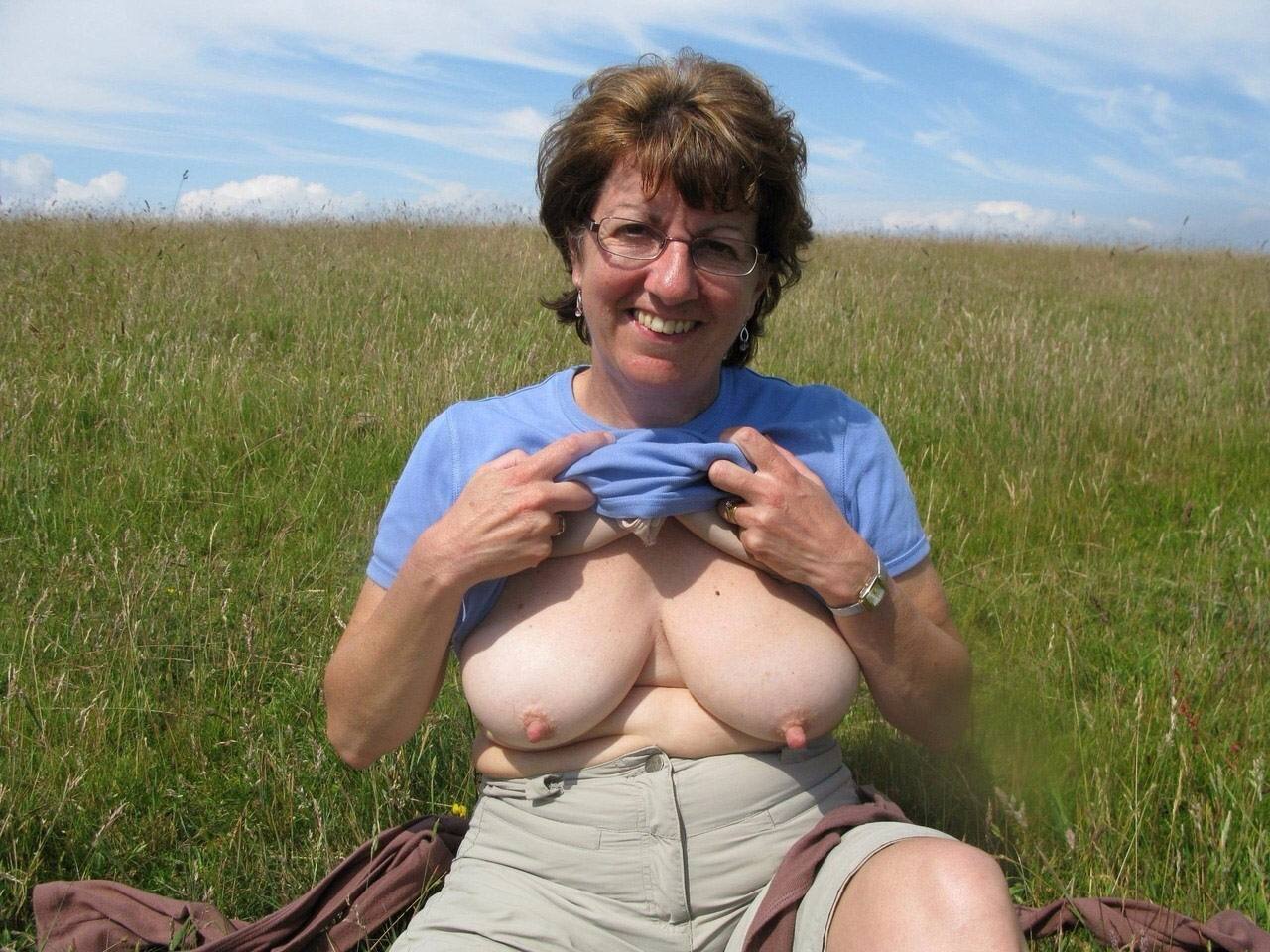 Mature women showing tits